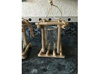 2 hanging driftwood candle holders