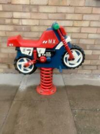 Vintage old school spring playground motor bike