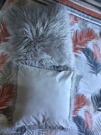 Fluffy grey cushion