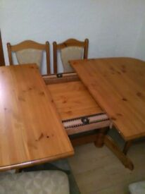 Solid extending table and 6 chairs. Really good condition.