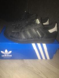 Trainers size 3/4 £15 each.