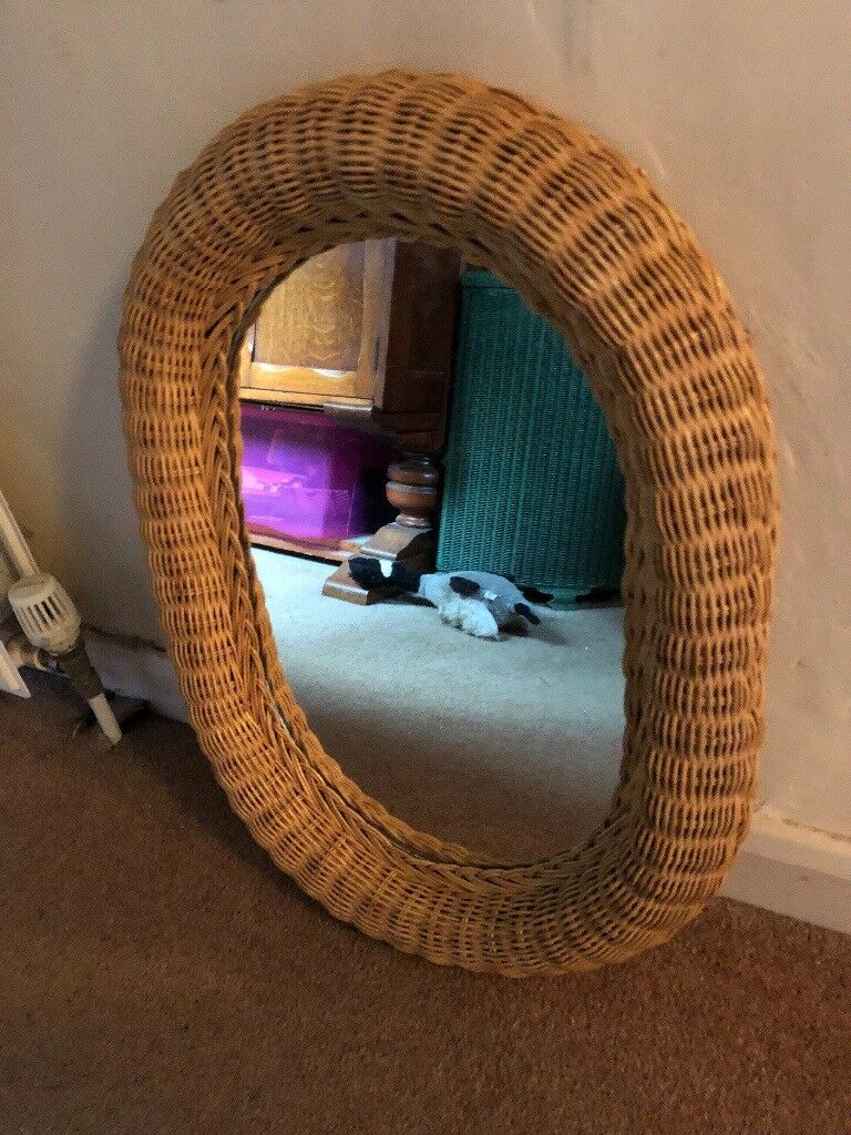 Oval wicker framed mirror
