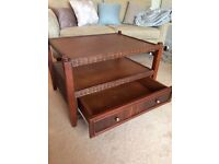 Matching coffee table/TV stand and shelving unit in dark brown wicker and bamboo.