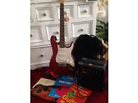 Ex quality 3/4 electric guitar and lots of extras