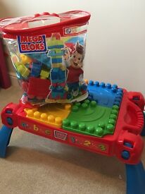 Mega blocks table and bricks - Includes a little man and car!