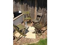 Four wooden garden chairs