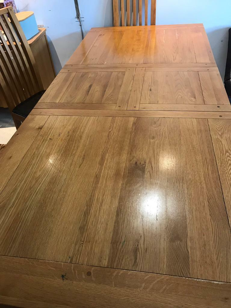 Solid Oak extending dining table (seats 8-10) and 6 solid ...