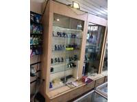 Three Display cabinet with counter