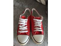 Red baseball shoes