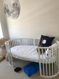 Stokke Sleepi cot and junior bed and naturalist mattress, mattress protector and fitted sheets