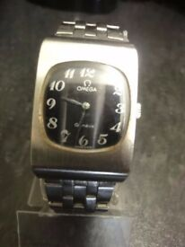 Vintage Unisex Omega Stainless Steel Geneva Watch, automatic,black face with ss bracelet 1970s