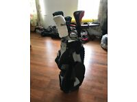 Full set of clubs with driver, putter and bag