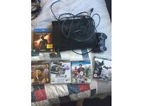 PLAY STATION 3 WITH CABLES, CONTROLLER AND 4 GAMES