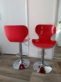 For Sale: Red Acrylic Kitchen Bar Stools with Chrome Trim on a Chromed Stem.