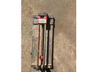 Tile cutter and laminate flooring