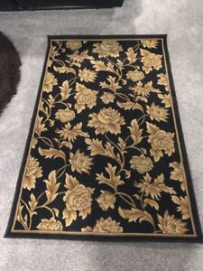 Gold and black area rug