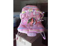 Pink/multi baby bouncer with toys - excellent condition