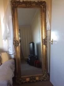 Fabulous Extra Tall Gold Gilt French Wall hall leaner mirror. Ornate and Opulent