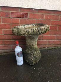 Weathered concrete garden bird bath