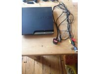 second hand PS3 with 3 remotes , 8 games and one charger cable.