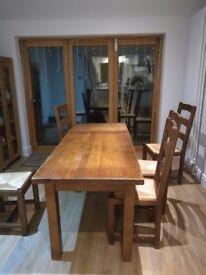 Oak dining table and chairs. Extendable
