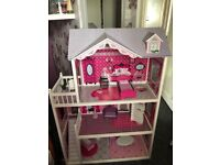 Huge dolls house includes accessories/dolls and clothes