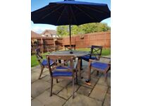 Garden wooden table, 6 chairs, cushions, parasol with lights.