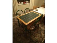 Table and 4 chairs - happy to receive offers