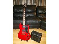 Nearly new electric guitar and amp
