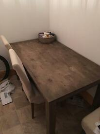 Lovely wooden table and chairs for sale