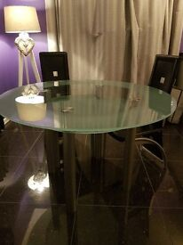 Glass circular dining room table for sale