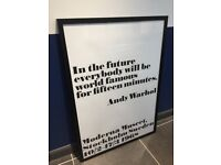 """Brand new Andy Warhol """"In the future"""" print in 100 cm x 70 cm glass picture frame."""