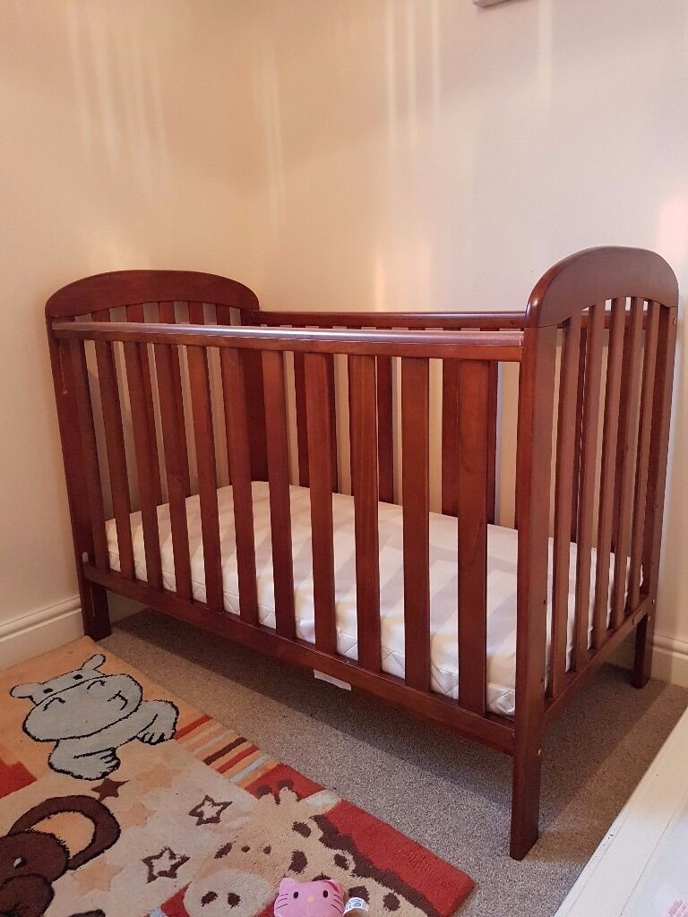 Beautiful dark wood Nursery Cot from Eastcote Nursery. No damages just outgrown, very good quality.