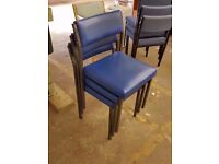 3 blue leather office chairs