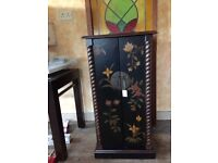 "Good quality chinoiserie style cabinet with lots of storage space 36""H X 18""W X 16""D. As new"