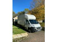 Man with box van and tail lift offering removals and full house clearances