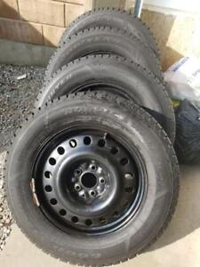 BRAND NEW HYUNDAI SANTA FE HIGH PERFORMANCE GOODYEAR NORDIC   WINTER TIRES 235 / 65 / 17 ON  STEEL RIMS.NEVER USED
