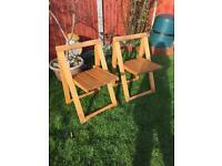 Two wooden fold up chairs