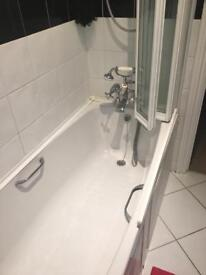 Bath with mixer taps