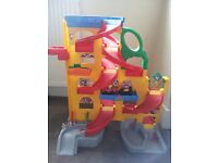 Fisher Price Little People garage vertical playset with two cars