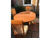 Extending dining table with four chairs ( can deliver )