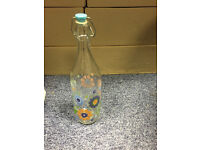 Old Style Glass Milk Bottle With Bold Flower Detail All Around Bottom