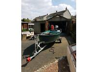 Fishing boat with trailer and engine with fish finder