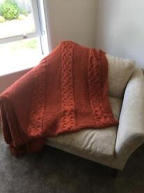 Orange knitted (shop bought) throw.