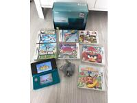 Nintendo 3ds in box with games and charger