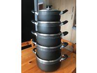 Set of five pans