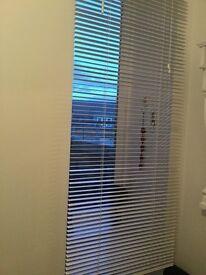 Longer length white wooden Venetian blind