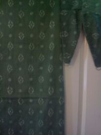 Lined green with small diamond print design curtains excellent condition with tie backs