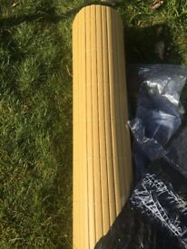 2 metres by 2 metres plastic bamboo trellis/screen. Bought by mistake.