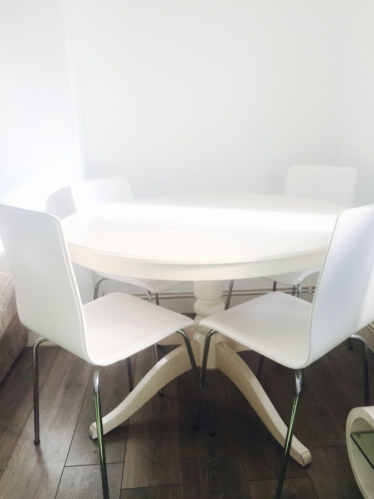 White ikea ingatorp extendable round table with four modern white chairs in kilburn london - Ikea round extendable table ...